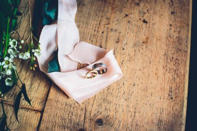 Jesse Knibbs Photographer - Lake District Wedding rings on table