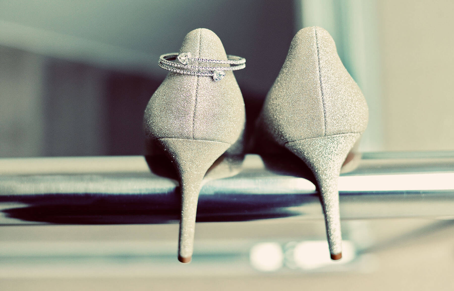Brides wedding shoes with a bracelet placed on top