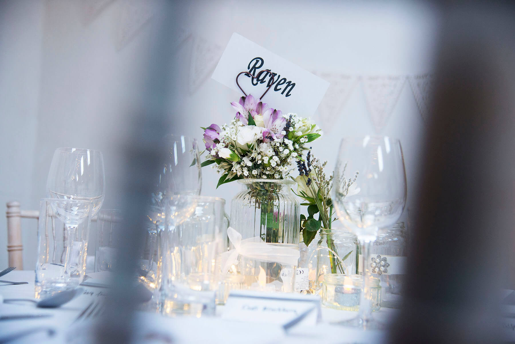 Table setting at a wedding reception with flowers