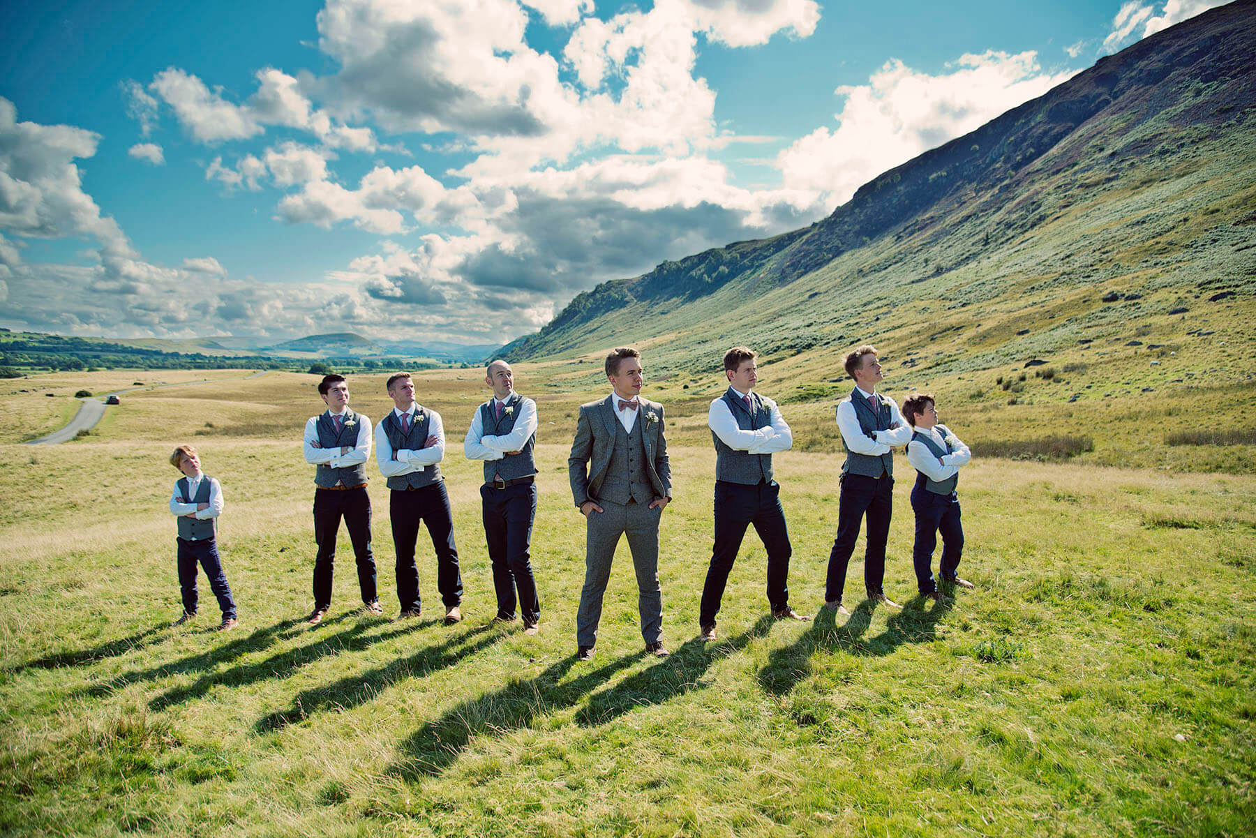 Groom and friends stood a mountainside in the Lake District